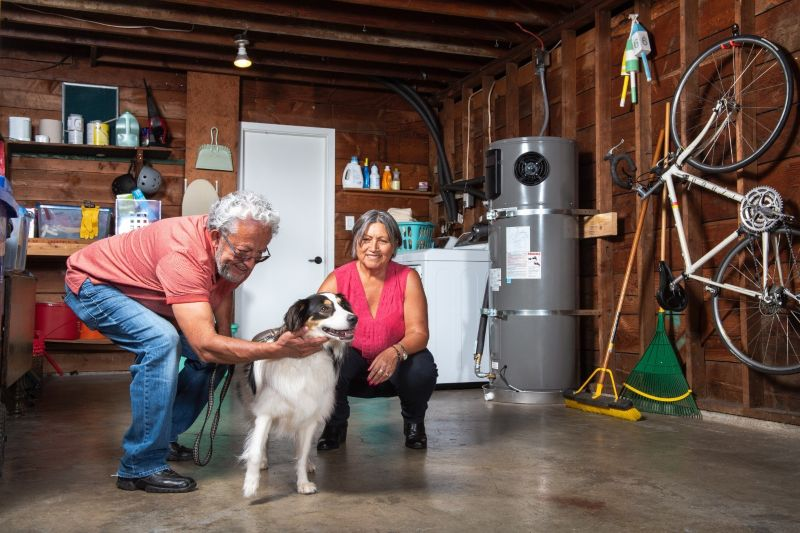Couple With Dog Next To Water Heater